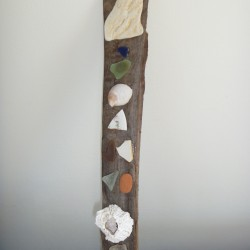 "Shells, beach glass and a bit of driftwood combine to make a ""totem"" that recalls the pleasures of summer beside a bay in Maine."