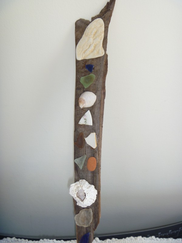 Shells, beach glass and a bit of driftwood combine to make a &quottotem&quot that recalls the pleasures of summer beside a bay in Maine.