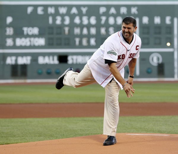 Former Boston Red Sox player Jason Varitek throws out the ceremonial first pitch before a baseball game between the Red Sox and the Toronto Blue Jays in Boston, Saturday, July 21, 2012. Varitek was honored for his time with the team in a pregame ceremony.