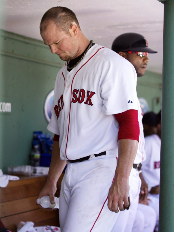 Boston Red Sox's Jon Lester reacts in the dugout after being pulled in the fifth inning after giving up runs to the Toronto Blue Jays during a baseball game at Fenway Park in Boston, Sunday, July 22, 2012. The Blue Jays won 15-7.
