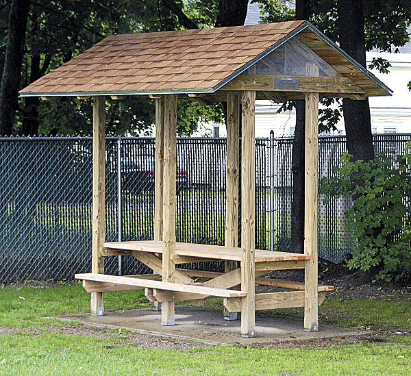 Local businesses, organizations, and individuals donated materials and labor to help construct this picnic table shelter at the playground adjacent to the Brewer Public Library. The project was the brainchild of Brewer Scout Mason Duplissie.