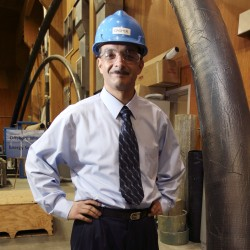 Habib Dagher, director of the Advanced Engineered Wood Composites Center at the University of Maine, poses at the school's testing laboratory in Orono in October 2008.