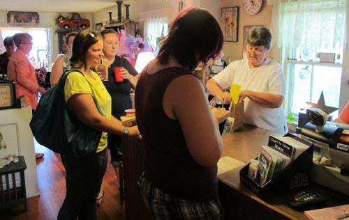 Participants in Bucksport's first Cash Mob line up at the register of Bittersweet Gift Shop on U.S. Route 1 on Friday, July 27, 2012.