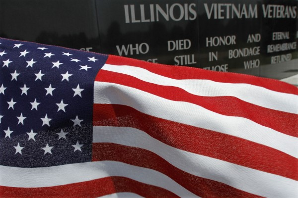 A United States flag blows in the wind near the Illinois Vietnam Memorial on Tuesday, July 3, 2012, in Springfield, Ill.