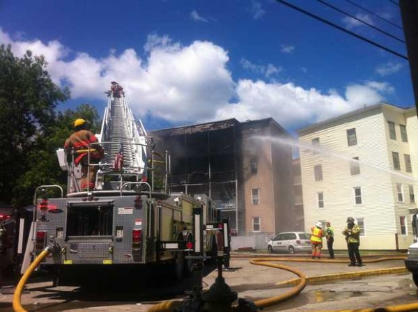 Firefighters battle an apartment fire at 34 River St. in Lewiston.