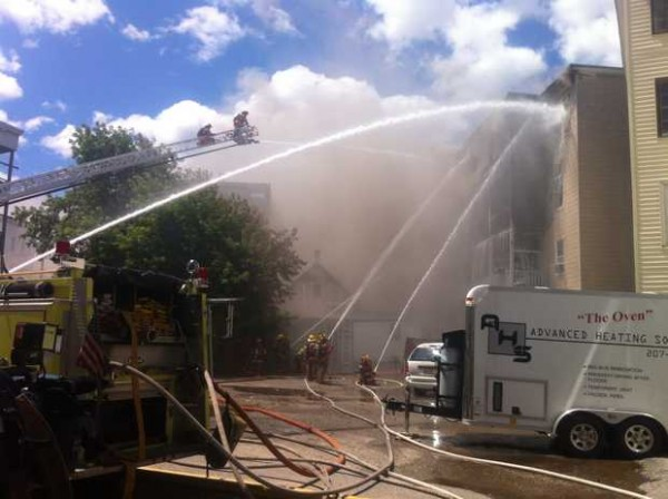 Firefighters battle a blaze at 32-34 River St. in Lewiston Tuesday.