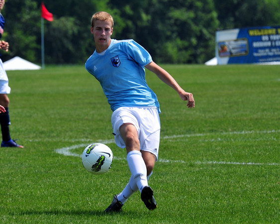 Wyatt Omsberg, 16, of Belgrade, Maine, passes the ball during a U.S. Youth Soccer Association 2012 Region I Championships under-16 boys game in Lancaster, Pa.