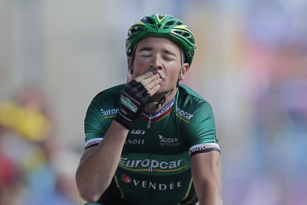 Thomas Voeckler of France crosses the finish line to win the 10th stage of the Tour de France cycling race over 194.5 kilometers (120.9 miles) with start in Macon and finish in Bellegarde-sur-Valserine, France, Wednesday, July 11, 2012.