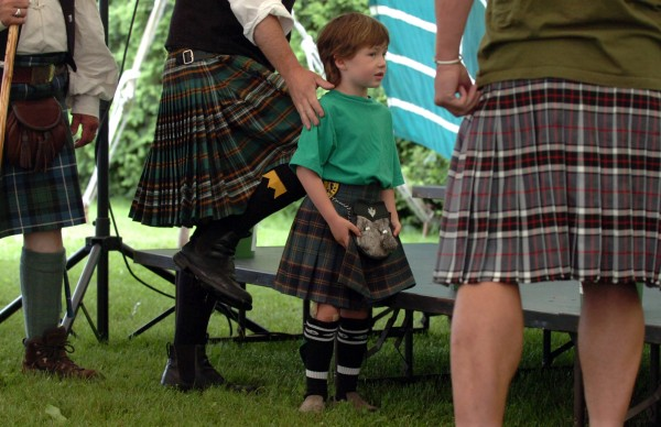 Conrad Burke, 5, of Thomaston prepares to compete alongside the men, including his father, Christopher burke (second from left), in the Men in Kilts Competition at the Maine Celtic Celebration in Belfast in July 2009.