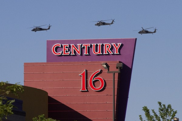 Three helicopters make a flyover of the Century Theater on Saturday, July 21, 2012 in Aurora, Colo. Twelve people were killed and dozens were injured in the attack early Friday at the packed theater during a showing of the Batman movie, &quotDark Knight Rises.&quot Police have identified the suspected shooter as James Holmes, 24.