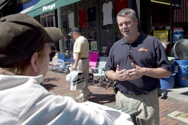 Republican candidate for 1st District House Jon Courtney (right) talks with a shop owner on Front Street during his &quotSolutions from Main Street Tour&quot in Bath on Tuesday, July 3, 2012.