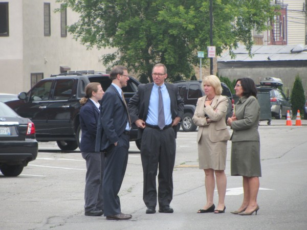Court officials await the arrival at about 8:30 a.m. Tuesday, July 17, 2012, of the jury in the Arnold Diana murder trial. The jury was allowed to view the rear and front of the Thorndike apartment building in Rockland.