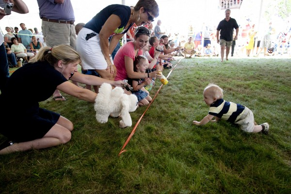 Angela Morris of Cumberland cheers as her baby, Jameson Brainerd, age 10 months, crawls to victory in the Diaper Derby on Sunday at the Yarmouth Clam Festival.