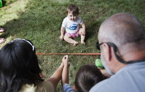 Lindsey Scheuchzer of Falmouth, age 10 months, stops just inches from the finish line during the Diaper Derby on Sunday at the Yarmouth Clam Festival.