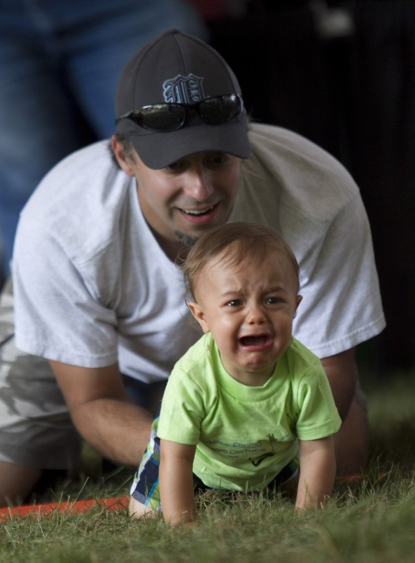 Drew Putnam of Limerick wants nothing to do with racing as his father, Dave, tries to encourage him at the starting line of the Diaper Derby.