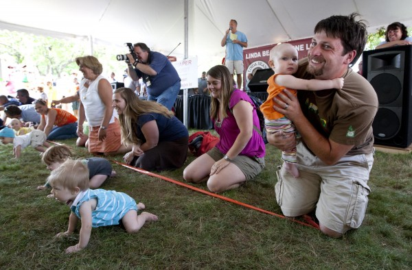 And they're off!  Well, most of them, anyway. A reluctant racer clings to his father at the start of a heat during Sunday's Diaper Derby at the Yarmouth Clam Festival.