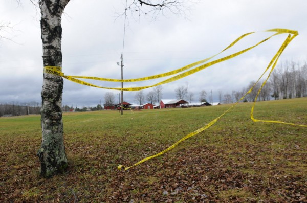 Crime scene tape flies in the wind at the Piscataquis Valley Fairgrounds on Wednesday, Nov. 30, 2011.