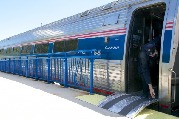 Amtrak Conductor Peter McHugh stows the gangway as the 2:35 p.m. Downeaster to Boston leaves Portland Tuesday, July 10, 2012.