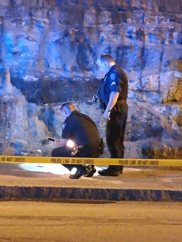 Lewiston police officers investigate the scene of a possible stabbing near the Basilica of Saints Peter and Paul late Sunday.