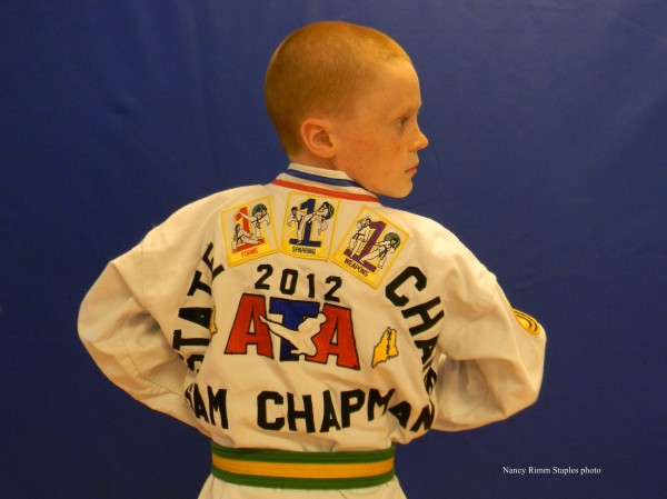 Sam Chapman wearing his State Champion jacket.