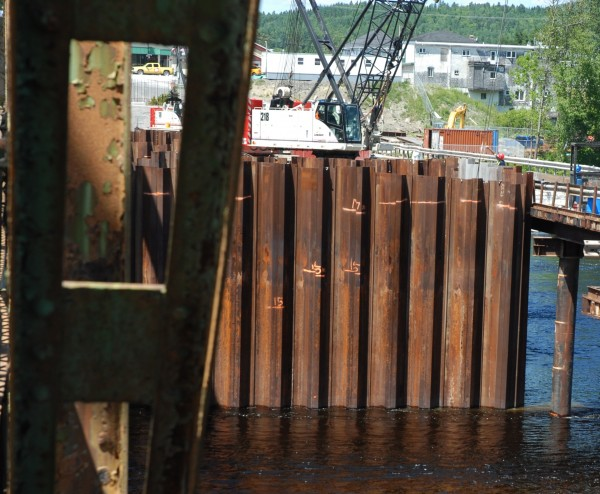 This view from the Maine side of the existing international bridge in Fort Kent shows one side of the cofferdam in which crews will work to construct pier two of the new bridge currently under construction.