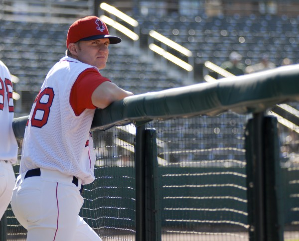 Boston Red Sox draft pick Kyle Kraus stands in the Lowell Spinners' dugout during a recent practice. THe University of Portland senior was drafted in the seventh round of the major league draft and signed for $1,000.