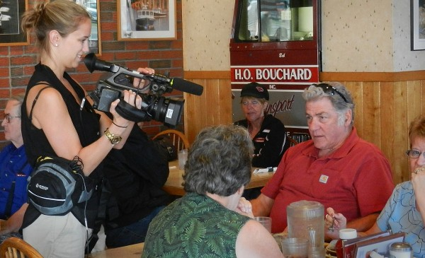 John Reno of Bath talked with &quotFood Paradise&quot associate producer Julie Laplaca, as she filmed footage at Dysart's Restaurant in Hermon for an episode of the Travel Channel show.