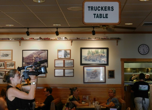 &quotFood Paradise&quot associate producer Julie Laplaca films the interior decor at Dysart's Restaurant in Hermon for an episode of the Travel Channel show.