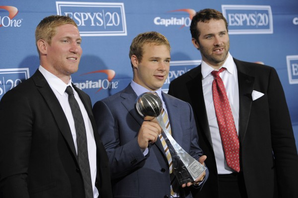 Los Angeles Kings' Matt Greene (from left), Dustin Brown and Dustin Penner pose backstage with their award for best upset at the ESPY Awards on Wednesday, July 11, 2012, in Los Angeles. Greene, Brown and Penner, a former University of Maine standout, helped the Kings win the Stanley Cup in June for the first time in the team's 45-year history.