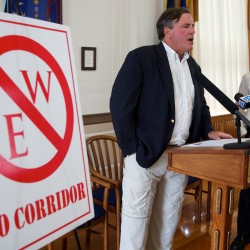 Jonathan Carter, director of the Forest Ecology Network (left) and Jym St. Pierre, executive director of Restore the Maine Woods, speak out against a proposed east-west highway corridor at a press conference in Portland on Monday.