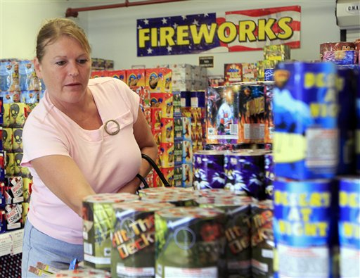 Sheila Grimes of South Berwick, Maine, looks through piles of fireworks at Hilltop Fireworks, Tuesday, July 3, 2012 in Somersworth, N.H.