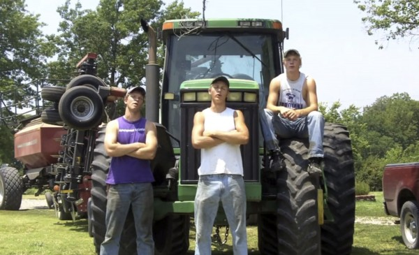 This frame grab from video shows Assaria, Kan., brothers, from left: Nathan; Greg and Kendal Peterson in their video parody on LMAFO's &quotSexy and I Know It.&quot  The parody, that has gone viral on YouTube and Facebook, shows the three brothers rapping their farming mission on the family's Saline County farm. (AP Photo/Courtesy Greg Peterson)