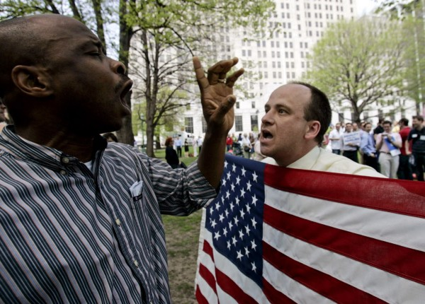 A gay rights advocate and opponent argue during a rally outside the Capitol in Albany, N.Y. A flurry of political activity in states such as Maine, Rhode Island, Illinois and Colorado followed President Barack Obama's declaration of support for gay marriage.