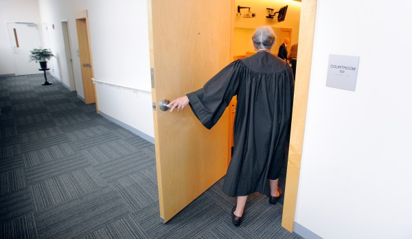 District Court Judge Jessie Gunther enters the courtroom at the Penobscot Judical Center in Bangor.