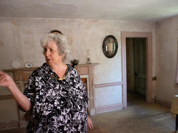 Bonnie Post of the The Mussel Ridge Historical Society points at pictures in the Old Homestead on Wednesday in Owls Head.