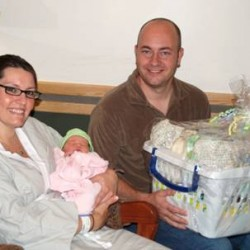 The staff at The Aroostook Medical Center in Presque Isle have been planning for the birth of the 100th baby born at the hospital this year, as this year marks TAMC's 100th birthday. That baby, Aiva Mae Richardson, was born on Wednesday, July 4, 2012. She is pictured here with parents Lisa Plourde and Adam Richardson of Caribou.