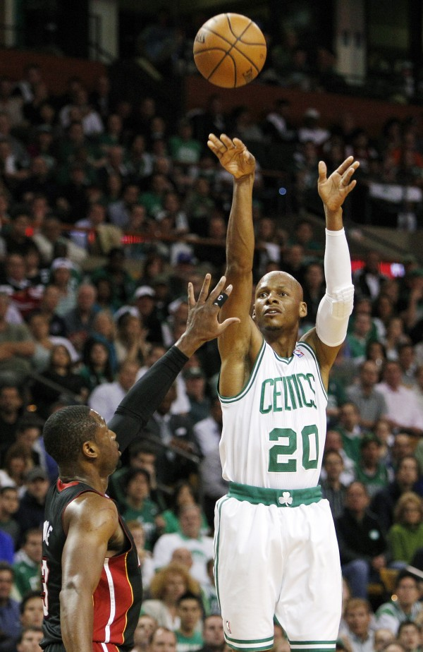 Boston Celtics guard Ray Allen (20) shoots a three-point basket over Miami Heat guard Dwyane Wade (3) during the first quarter of Game 4 in their NBA basketball Eastern Conference finals playoff series in Boston on June 3. Allen told the Heat on Friday night, July 6, 2012, that he has decided to leave the Celtics and join up with the reigning NBA champions