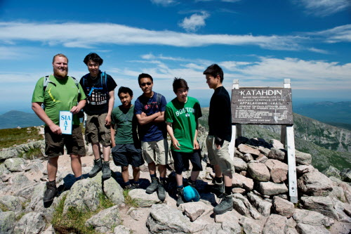 Rene Kristensen, founder and president of IAT Greenland, stands at the summit of Mount Katahdin in Baxter State Park with teenagers from The Children´s Home Uummannaq in Greenland, on July 10, 2012. Their hike up Mount Katahdin marked the first day of their 12-day trek on the International Appalachian Trail in Maine.