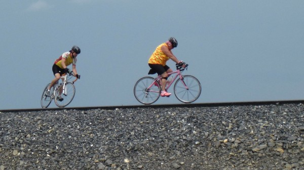 A pair of Aroostook County cyclists check out the new pavement on the Caribou connector last week. The 4.8-mile route will take truck and other traffic around downtown Caribou connecting routes 161 and 1. MDOT officials are hoping the route is open Aug. 17 for vehicular traffic.