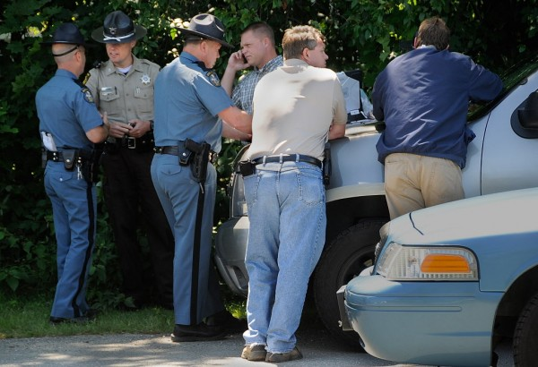 State police and Penobscot County sheriff's deputies converge at Glenburn School on Hudson Road Monday morning, July 9, 2012.
