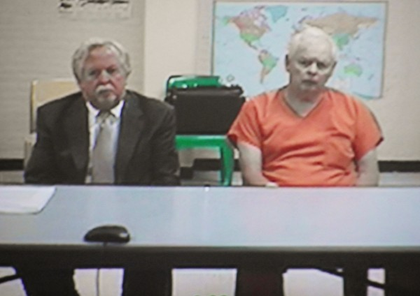 George Jaime Sr (right) of Presque Isle, sits with his attorney, Alan Harding, in a conference room at the Aroostook County Jail in Houlton on Friday, July 13, 2012. Jaime made an initial appearance via videoconferencing on charges of intentional or knowing murder in the Oct. 1998 death of Starlette Vining of Presque Isle. Jaime is being held without bail.