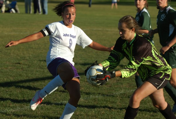 MDI goalie Elizabeth Sargent (right) grabs the ball before John Bapst of Bangor's Whitney Sinclair can take a shot during a game in 2007. Sinclair, a former Bapst and UMFK standout, has been named the new varsity girls soccer coach at Foxcroft Academy.