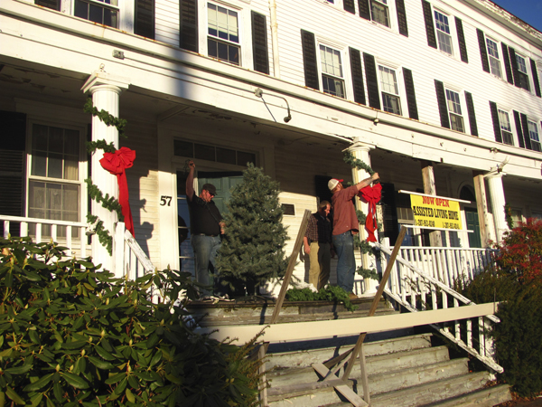 Workers were busy decorating the front porch of the Jed Prouty Inn in Bucksport for the holidays in December 2011, several days after John and Rhonda Chambers of Calais purchased the historic building.