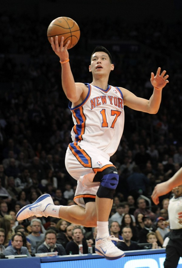 In this Feb. 4, 2012, file photo, New York Knicks' Jeremy Lin drives to the basket during the second quarter of an NBA basketball game New Jersey Nets at Madison Square Garden in New York.