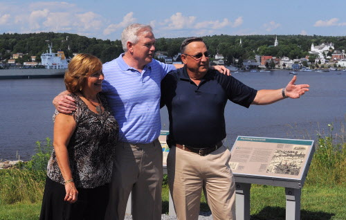 Gov. Paul LePage (right) and his wife Ann LePage (left) have their picture taken with conservative radio talk-show host Howie Carr at the Economic Freedom Festival at Fort Knox in Prospect on Saturday afternoon, July 7, 2012.