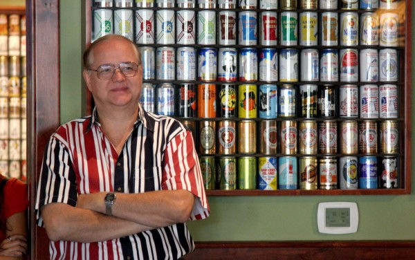 David Goett of Livermore, Calif., poses for a photo with his beer can collection on Tuesday, July 3, 2012.