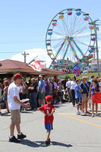 At the Maine Lobster Festival in August 2011, Matt Aber and his 6-year-old son Ryan Aber waited for mom to get some lunch.