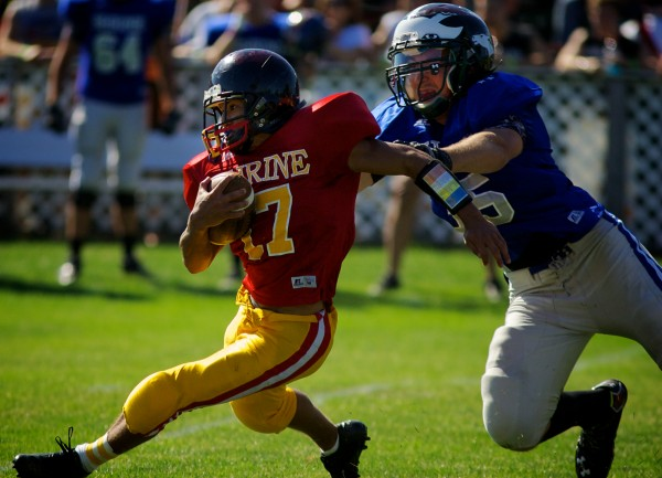 Anthony Jackson of the East, representing Brewer High School, runs away from the West's Matthew McLean, representing Windham High School, in the 23rd  annual Maine Shrine Lobster Bowl Classic in Biddeford Saturday July 21, 2012. The West won 48-24. (Bangor Daily News photo by Troy R. Bennett)