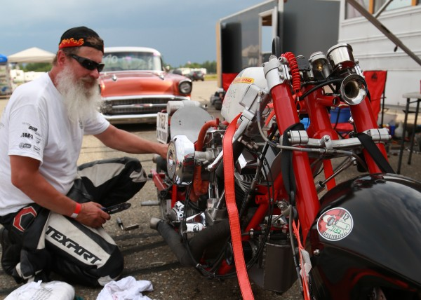 Don Roberts of Bridgton does a few adjustments to his custom Harley Davidson after his first run at the Loring Timing Association speed trials in Limestone Friday, July 13, 2012. Roberts' first run was 145 mph. More than 150 cars and motorcycles will test their skills with races beginning at noon Friday, 9 a.m. Saturday and 8 a.m. Sunday. Competitors will attempt to set records at the mile and 1.5-mile distances on two of Loring''s 2.5-mile runways.