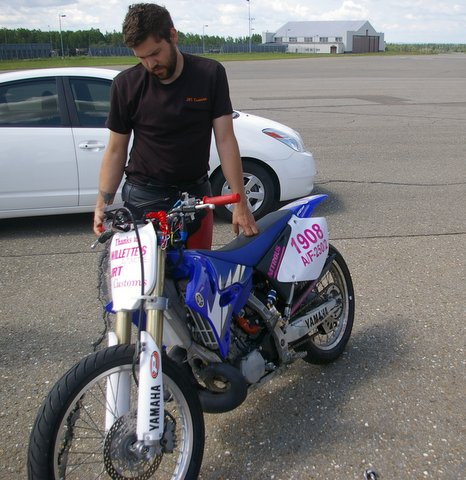 Jason Theriault of Limestone prepares his Yamaha 250 for a trail run at the former Loring Air Force Base. Michaud will will attempt to set a world record for the fastest dirt bike during this weekend's Land Speed Races in at Loring.